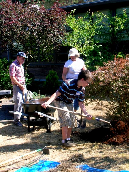 three people gardening outside if Viewlands Elementary